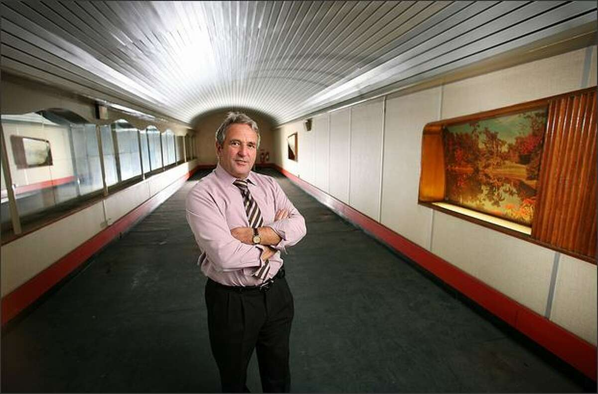 Former British Telecom employee John Tasker stands in a an old canteen in a secret air raid tunnel on October 17, 2008 in London. The once secret tunnels were built 100 feet under central London in 1940 as fully equipped air raid shelters and could accommodate 8000 people. They have since been used by MI6 and the Public Records Office to hold 400 tons of secret documents. Current owners British Telecom (BT) once housed the London trunk exchange of the secure Transatlantic hot line between the Presidents of the US and the Soviet Union. BT are now seeking a buyer as the tunnels are surplus to requirements.