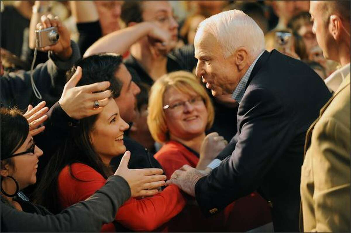Republican presidential candidate John McCain greets supporters at a campaign rally at Otterbein College in Westerville, Ohio, on Sunday.