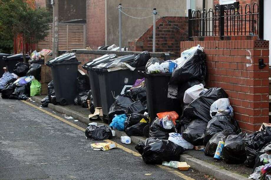 Overflowing garbage bins litter the streets in the Headingley area of Leeds, England. As a strike by garbage collectors enters its sixth week, many streets are overflowing with rubbish, creating a public health hazard. The strike centers on a proposal to cut the workers' wages by 5,000 pounds due to recent equality legislation. Photo: Getty Images / Getty Images