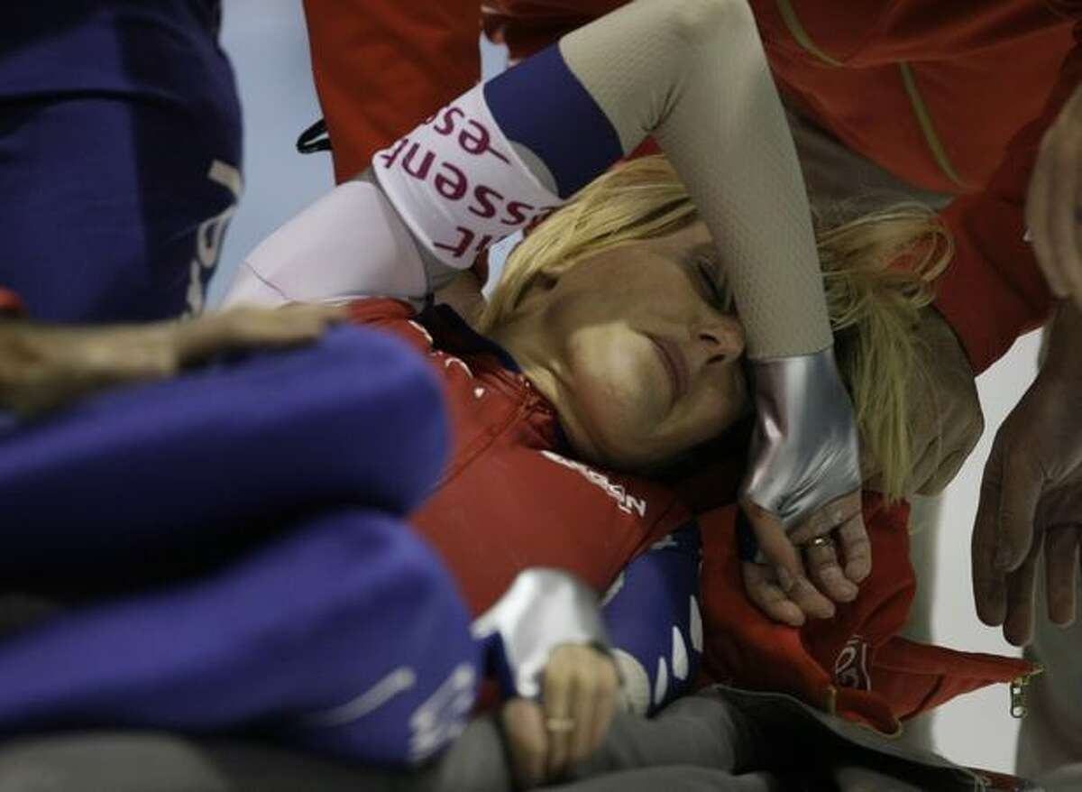 Marianne Timmer of The Netherlands grimaces as she is carried onto a stretcher after crashing during the 500 meters race the Speedskating World Cup at Thialf stadium in Heerenveen, northern Netherlands, Friday. (AP Photo/Peter Dejong