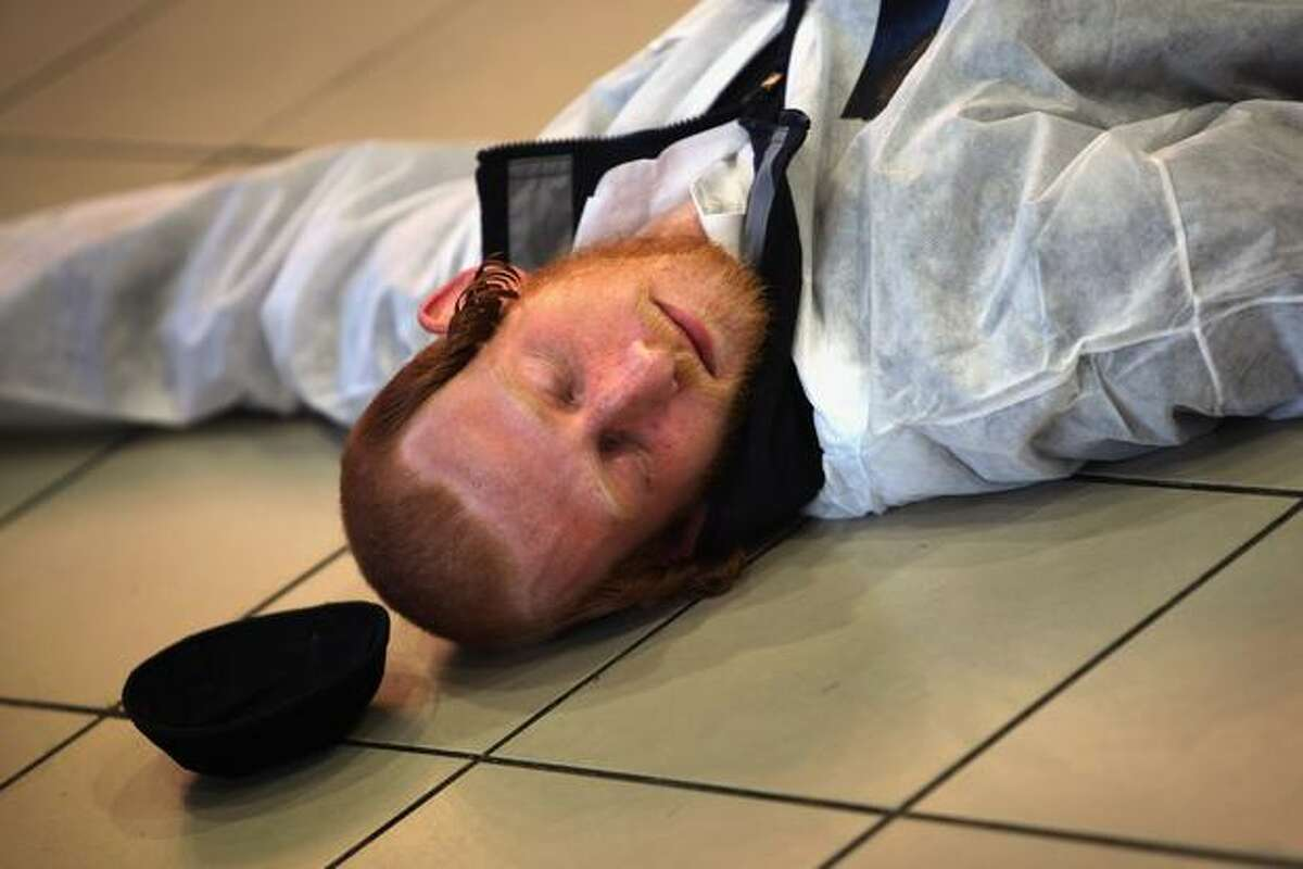 An ultra-Orthodox Jew plays the role of a fatality of a chemical warfare terror attack in the food court of a shopping mall during a training exercise on Sunday in Jerusalem, Israel. With the Lebanese Hezbollah militia threatening that all of the Jewish State is in range of its missiles, and the Islamic group Hamas in Gaza test-firing missiles that can reach as far as Tel Aviv, Israeli security forces all over the country have held recently civil defence exercises with both mass casualty and chemical warfare scenarios.