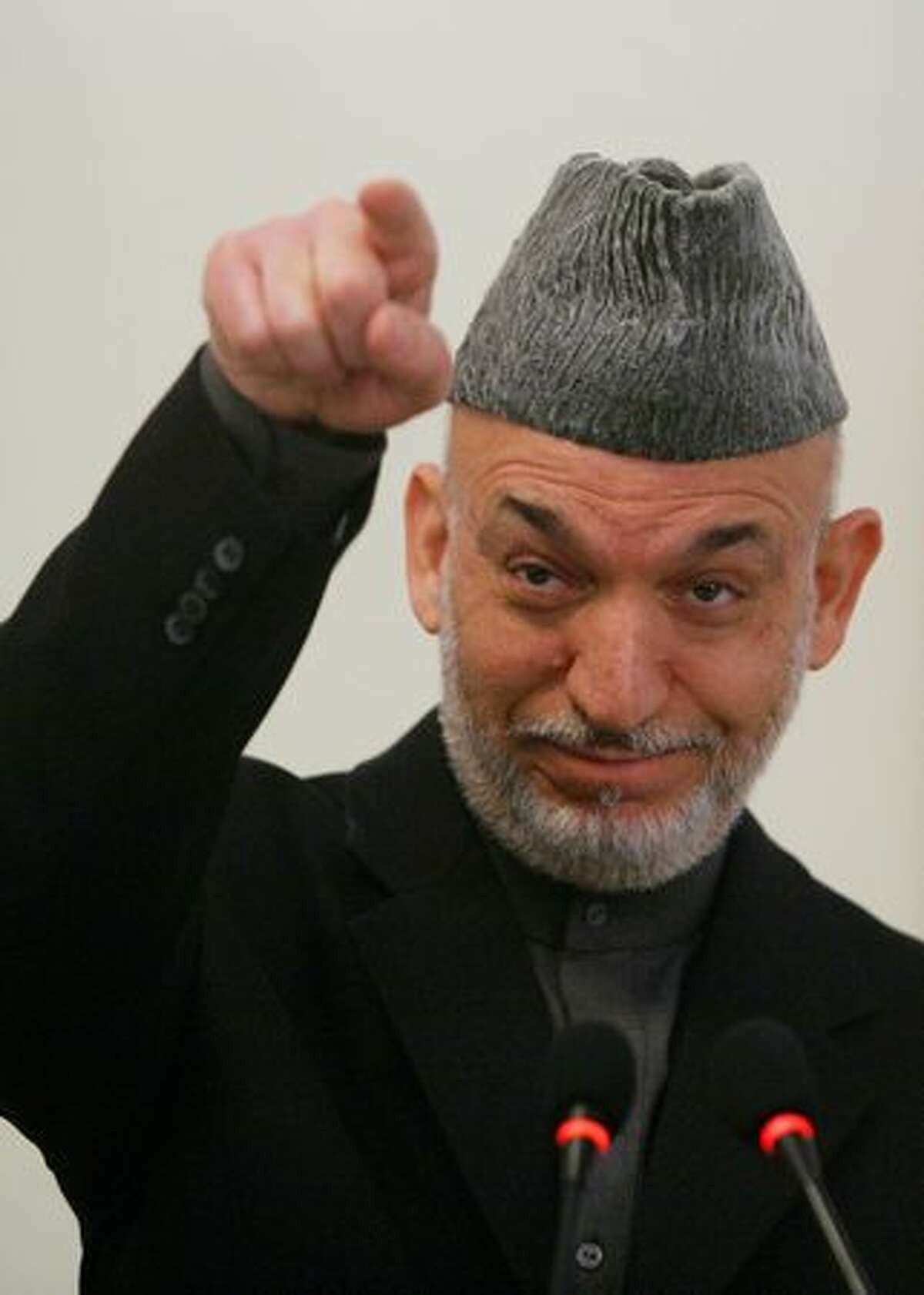 Afghanistan's President Hamid Karzai attends a joint press conference with Belgian Prime Minister Yves Leterme on Sunday in Kabul, Afghanistan. Karzai faced strong criticism regarding his propsed new cabinet. The attorney general's office is currently investigating both serving and former ministers in relation to corruption charges.