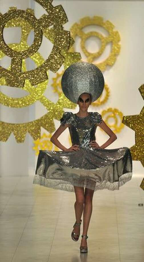 A model displays clothes from a ready to wear collection by Ukrainian fashion designer Olexiiy Zalevskiy during Ukrainian Fashion Week in Kiev. Photo: Getty Images / Getty Images
