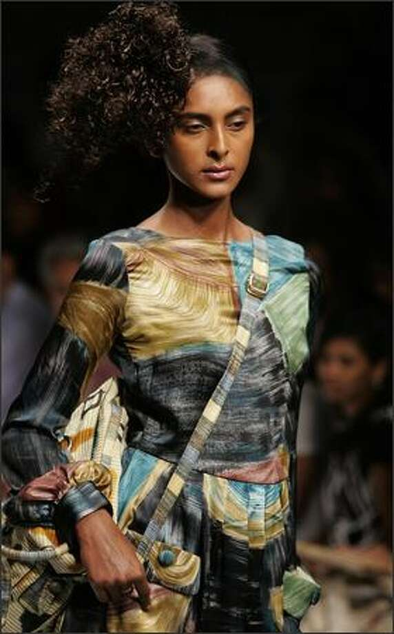 A model displays a creation by Indian designer Sudhir Tapash during the second day of The Lakme Indian Fashion Week (LIFW) in Mumbai on March 30, 2008. Some 57 designers are unveiling their autumn-winter collections at the five-day fashion festival in the western Indian city which is scheduled to end April 02. Photo: Getty Images / Getty Images