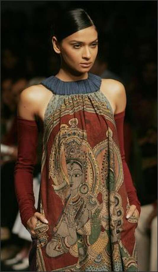 A model displays a creation by Indian designer Asmita Marwa during the Lakme Indian Fashion Week (LIFW) in Mumbai on Tuesday. Some 57 designers are unveiling their autumn-winter collections at the five-day fashion festival in the western Indian city which is scheduled to end April 02. Photo: Getty Images / Getty Images