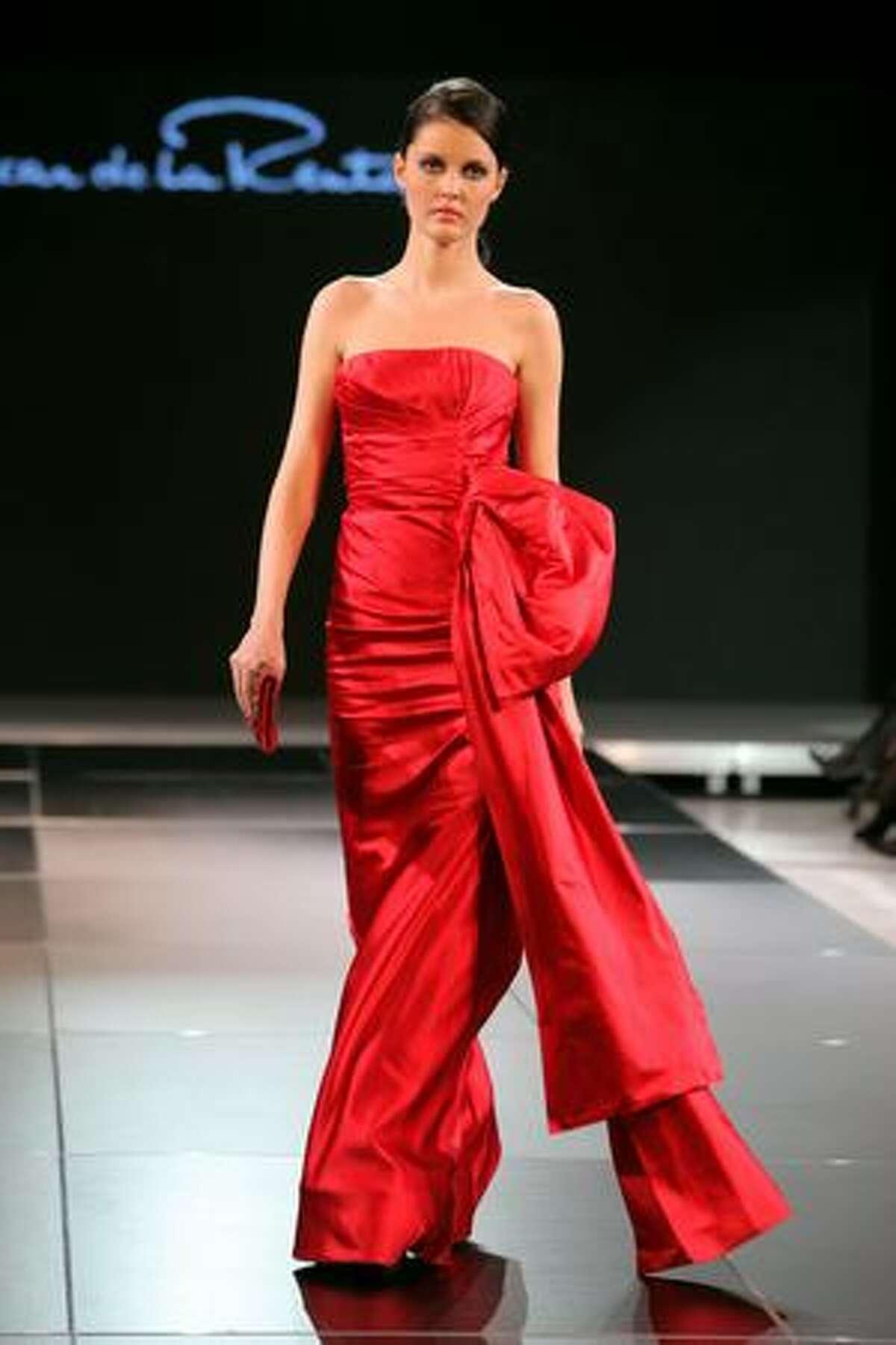 A model walks down the runway during the Oscar De La Renta Fashion Show in Tashkent, Uzbekistan.