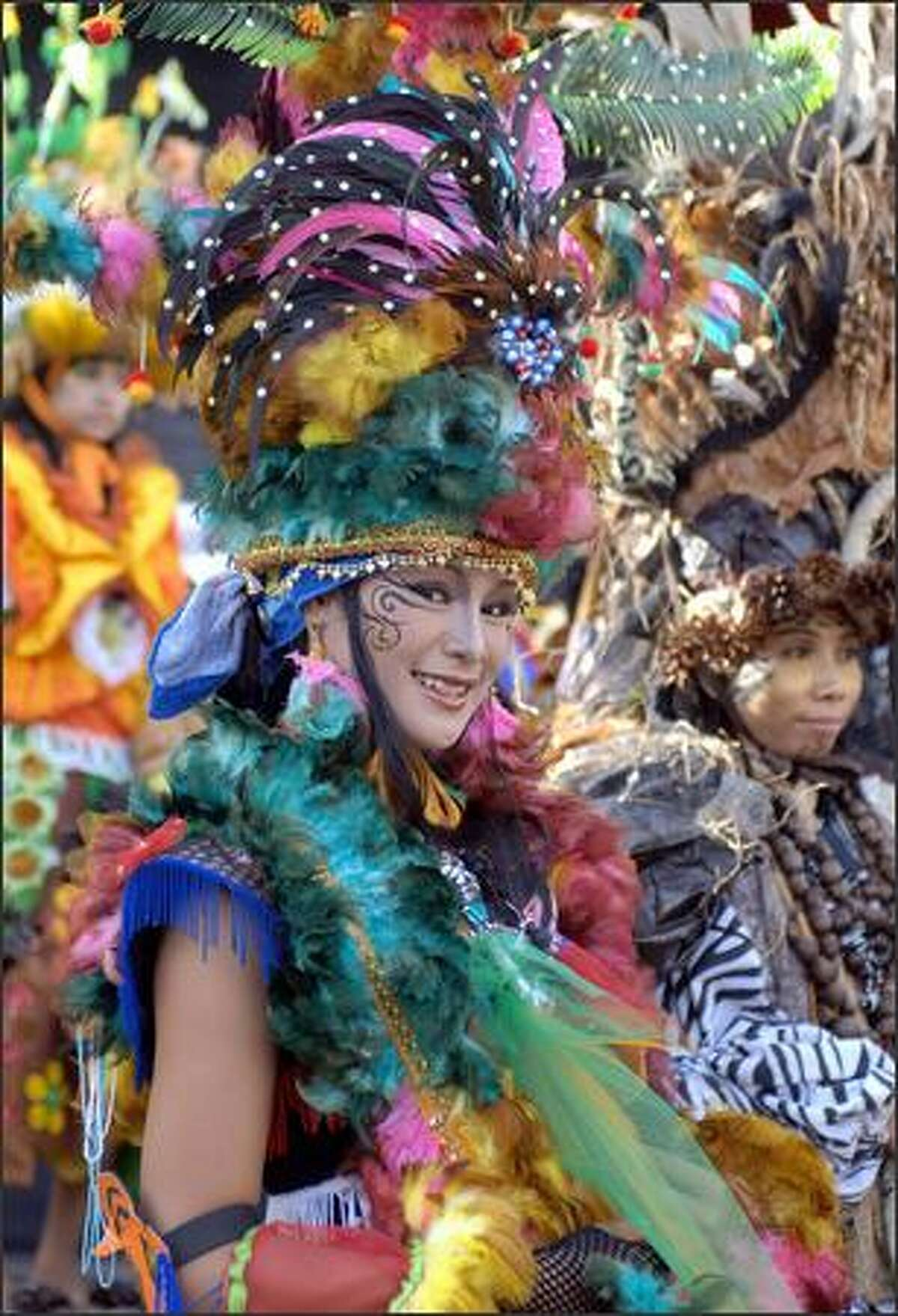 A model performs in a Borneo-style outfit during the Bali Fashion Festival in Kuta area of Denpasar, on Bali island, 25 November 2007. Bali Fashion Week is held 22-25 November as part of the local government's program to attract tourists.