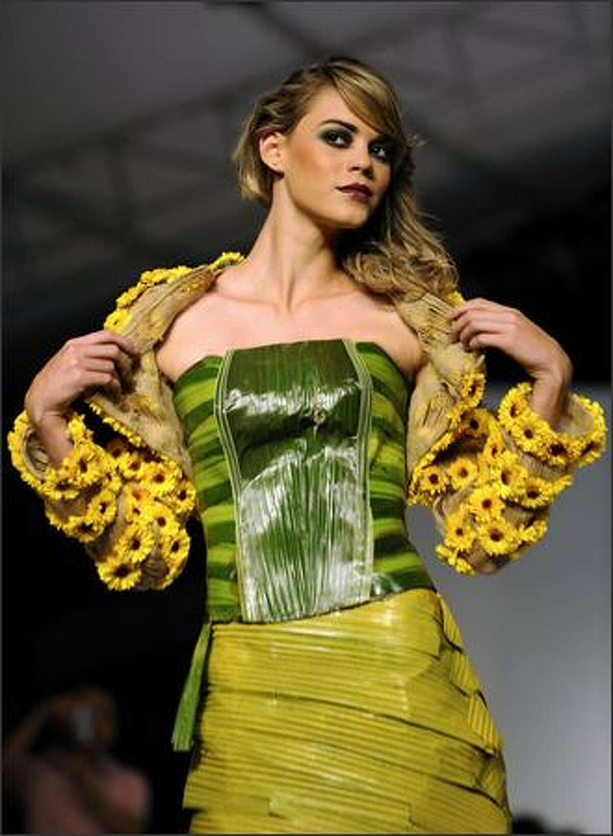 A model presents a creation by Colombian designer Pablo Cesar Dorado that used organic elements on her Bio-Fashion Show on Saturday in Cali, department of Valle del Cauca.