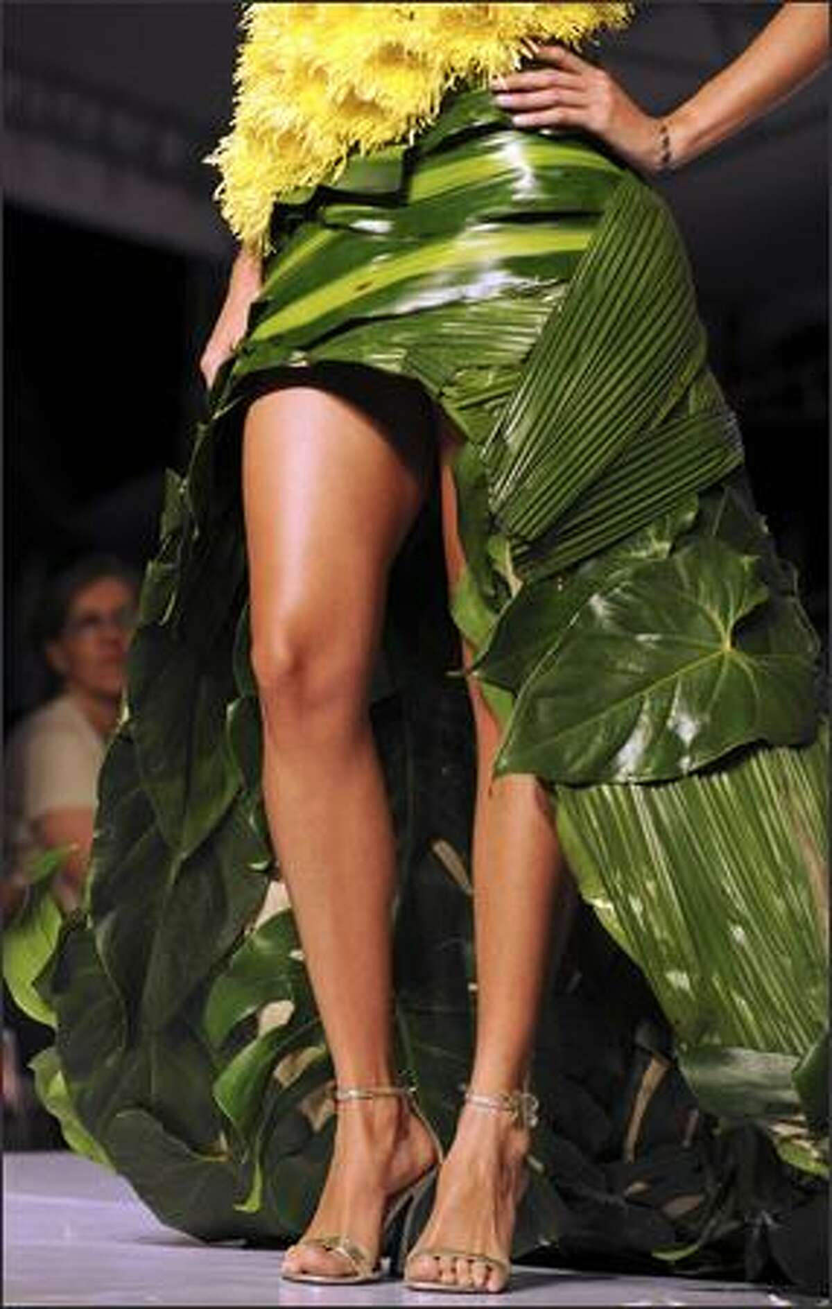 A model presents a creation by Colombian designer r Erika Bolaños that used organic elements on her Bio-Fashion Show on Saturday in Cali, department of Valle del Cauca.