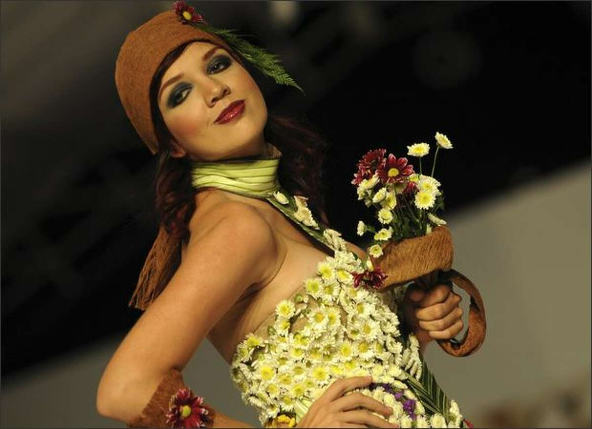 A model presents a creation by Colombian designer María Nubia Ayala that used organic elements on her Bio-Fashion Show on Saturday in Cali, department of Valle del Cauca.