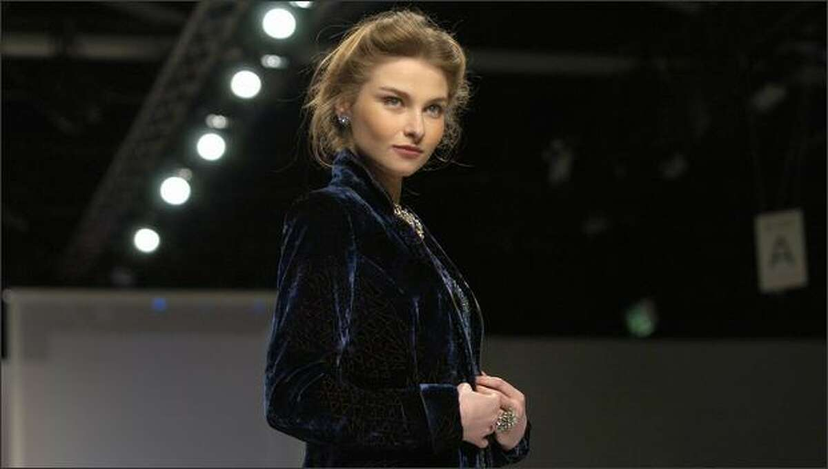 A model poses on the runway at the Caroline Charles catwalk show at the BFC Tent in London.