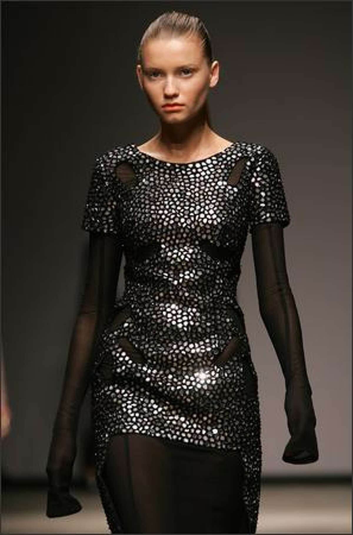 A model walks down the catwalk during the Marios Schwab fall 2008 show in London.