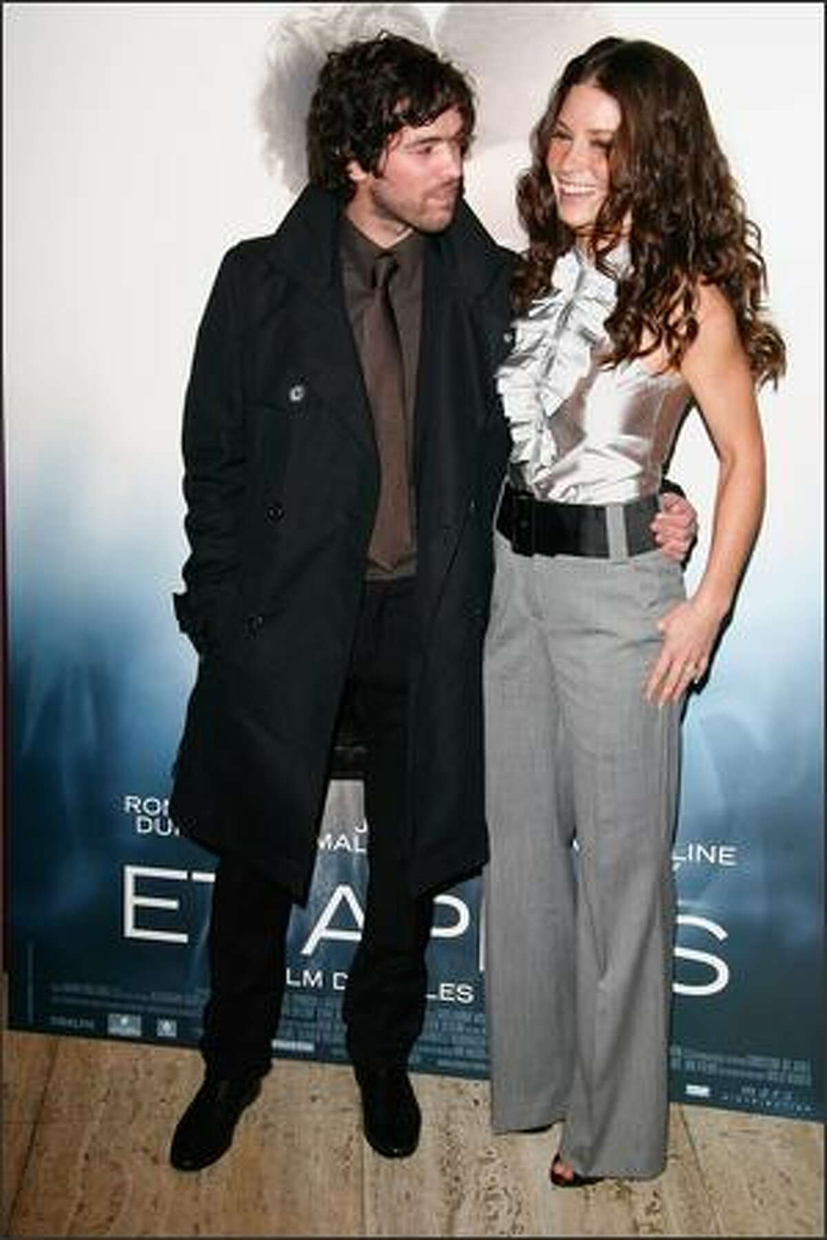 Romain Duris (L) and Evangeline Lilly attend the 'Et Apres' Paris premiere at the Gaumont ambassade cinema on Monday in Paris, France.
