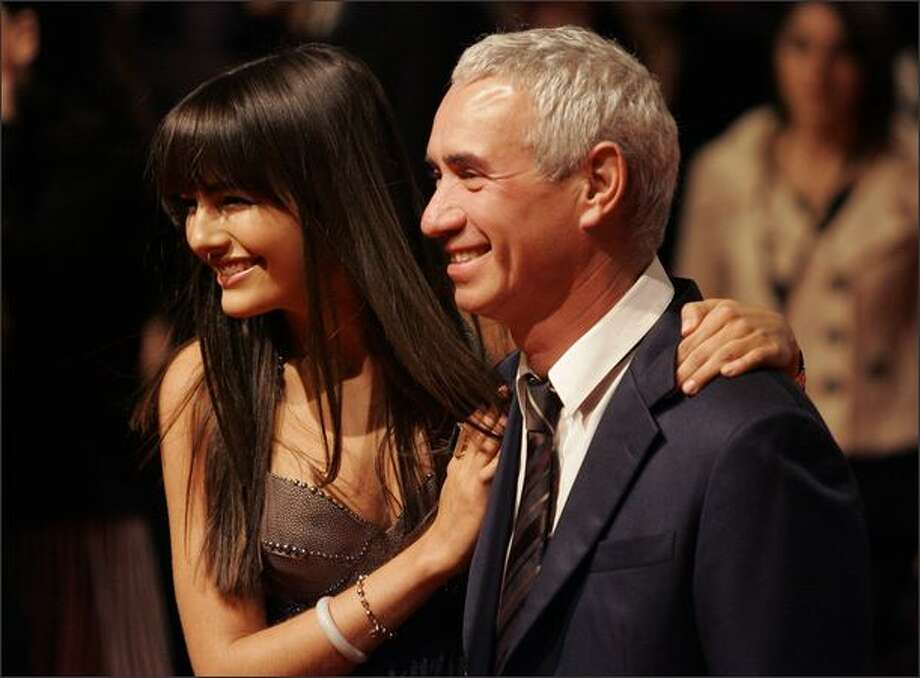 """Movie star Camilla Belle, left, and director Roland Emmerich, right, pose prior to their premiere of the movie """"10,000 B.C."""" in Berlin on Tuesday.(AP Photo/Fritz Reiss)"""