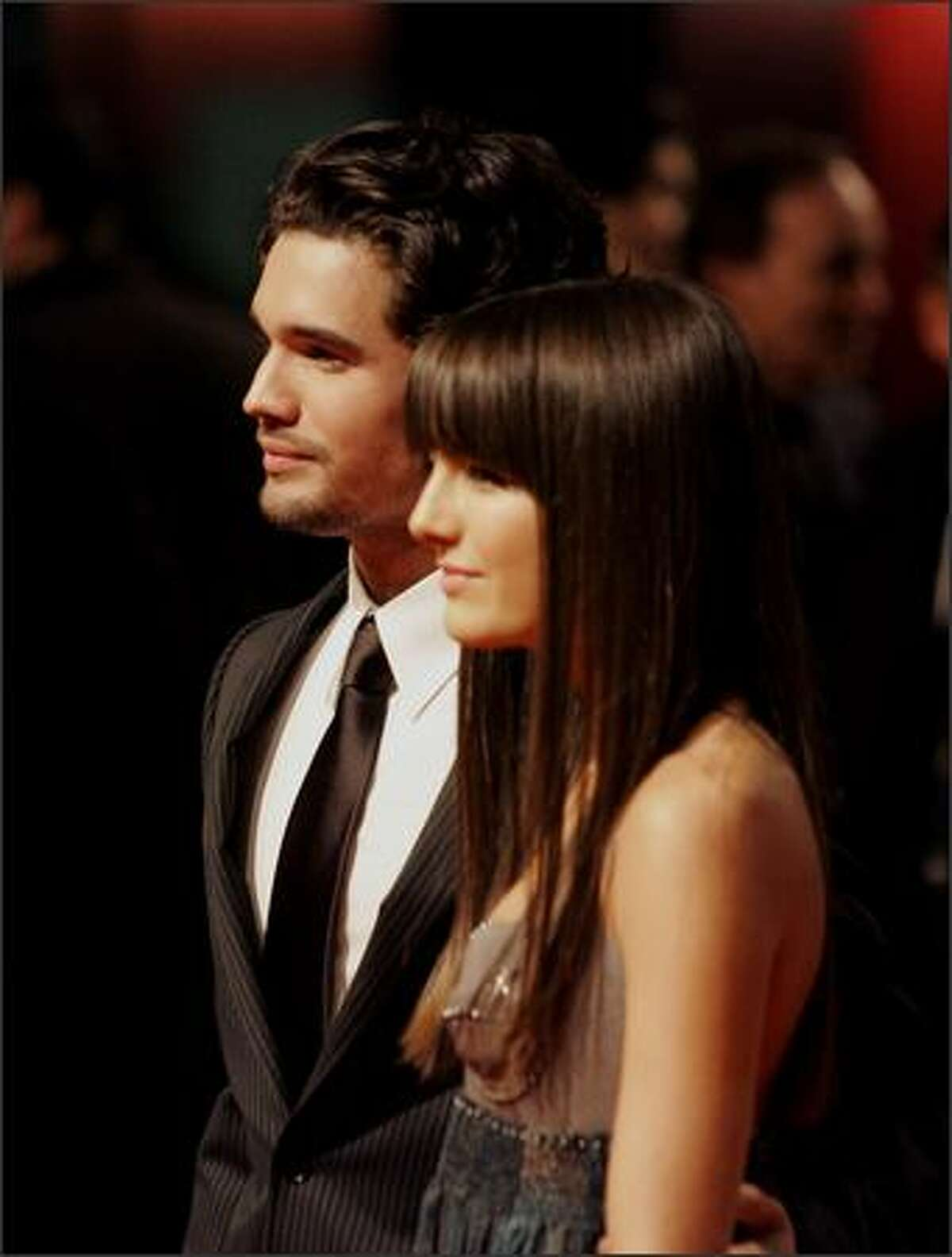 Actor Steven Strait, left, and actress Camilla Belle, right, pose prior to their premiere of the movie