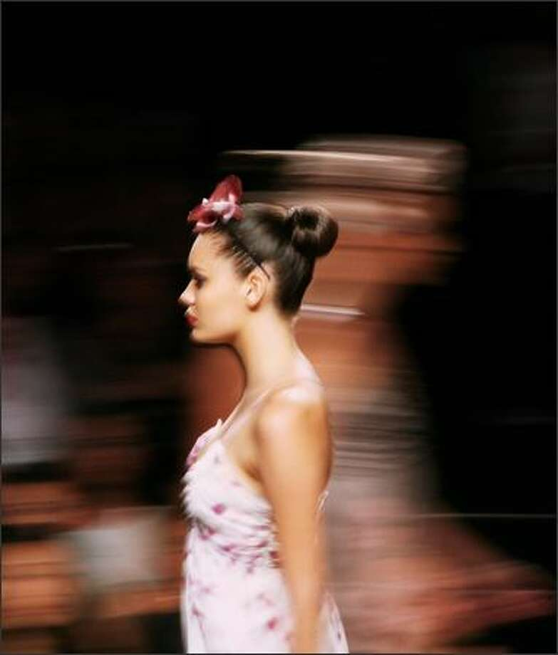 A model walks the catwalk wearing designs by DKNY during the Runway Deluxe show by Myer supported by Madison as part of the L'Oreal Melbourne Fashion Festival in City Square on March 6, 2008 in Melbourne, Australia. Photo: Getty Images / Getty Images