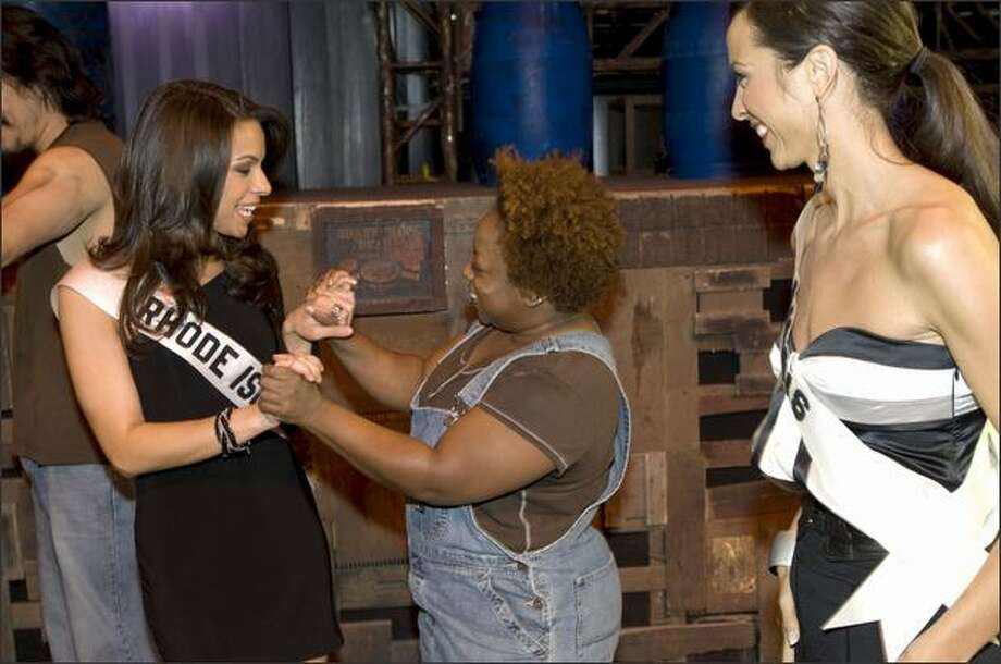 "Amy Diaz, Miss Rhode Island USA 2008, and Shanon Lersch, Miss Illinois USA 2008, meet cast member Rochelle G. Patterson from ""Stomp Out Loud"" at Planet Hollywood Resort and Casino in Las Vegas on March 31. They will compete for the title of Miss USA 2008 during the NBC broadcast of the 57th annual Miss USA competition from Las Vegas on April 11. Photo: Miss Universe L.P., LLLP / Miss Universe L.P., LLLP"