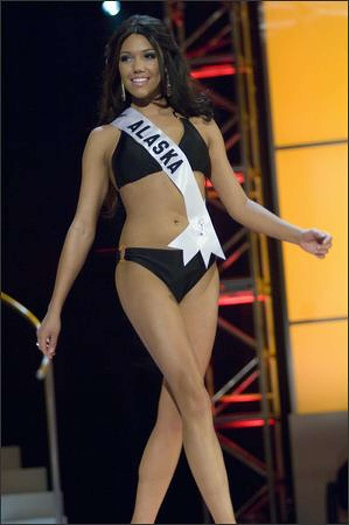 Courtney Erin Carroll, Miss Alaska USA 2008, performs during the swimsuit competition at the 2008 Miss USA Presentation Show in the Planet Hollywood Theatre in Las Vegas on April 5. The Presentation Show is part of preliminary judging, in which the 51 contestants are judged on swimsuits, evening gowns and interviews. The top 15 after preliminary judging will be announced at the outset of the finals on Friday, April 11. A completely different panel of judges will then judge the top 15 in swimsuits to narrow the field to 10; those 10 will then be judged in evening gowns to narrow the field to five, who will answer questions in a mini-interview before Miss USA 2008 is named.