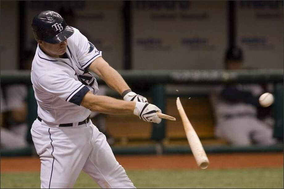 Tampa Bay Rays' Mike DeFelice breaks his bat on a RBI-single off Seattle Mariners pitcher Miguel Batista during the sixth inning. (AP PhotoSteve Nesius) Photo: Associated Press / Associated Press