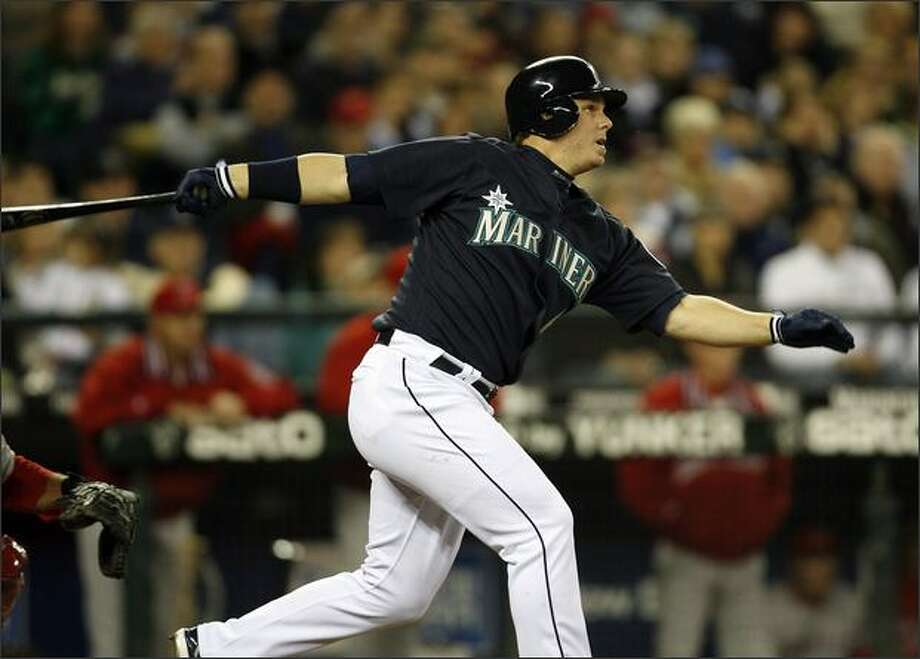 Seattle Mariners Brad Wilkerson singles on a line drive to center batting in two runs against the Los Angeles Angels during sixth inning action at Safeco Field. Photo: Mike Urban, Seattle Post-Intelligencer / Seattle Post-Intelligencer
