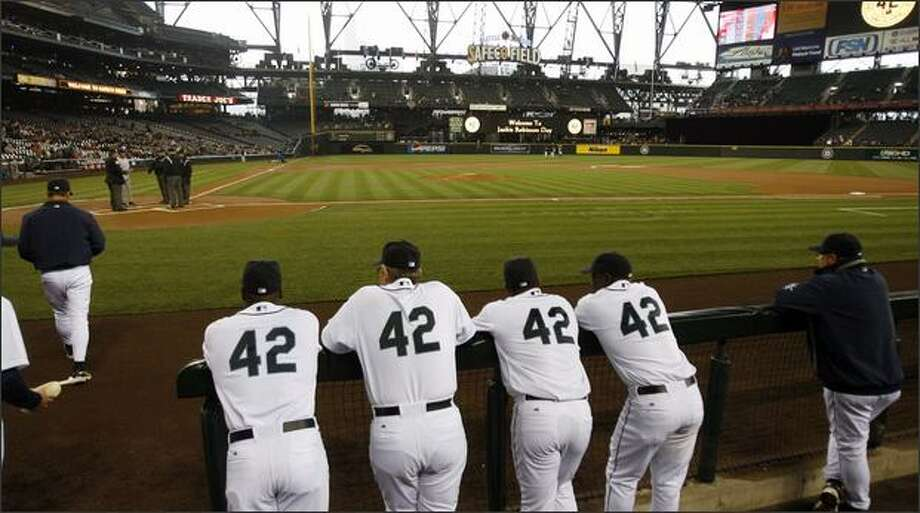 Mariners wear #42 to honor Jackie Robinson look on the field before a game against the Kansas City Royals. (l-r) Arthur Rhodes, Manager John McLaren, Adrian Beltre and Yuniesky Betancourt. Photo: Grant M. Haller, Seattle Post-Intelligencer / Seattle Post-Intelligencer