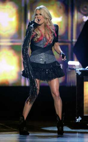 LAS VEGAS, NV - APRIL 03:  Singer Carrie Underwood performs onstage at the 46th Annual Academy Of Country Music Awards held at the MGM Grand Garden Arena on April 3, 2011 in Las Vegas, Nevada.  (Photo by Ethan Miller/Getty Images) *** Local Caption *** Carrie Underwood Photo: Ethan Miller, Getty Images / 2011 Getty Images