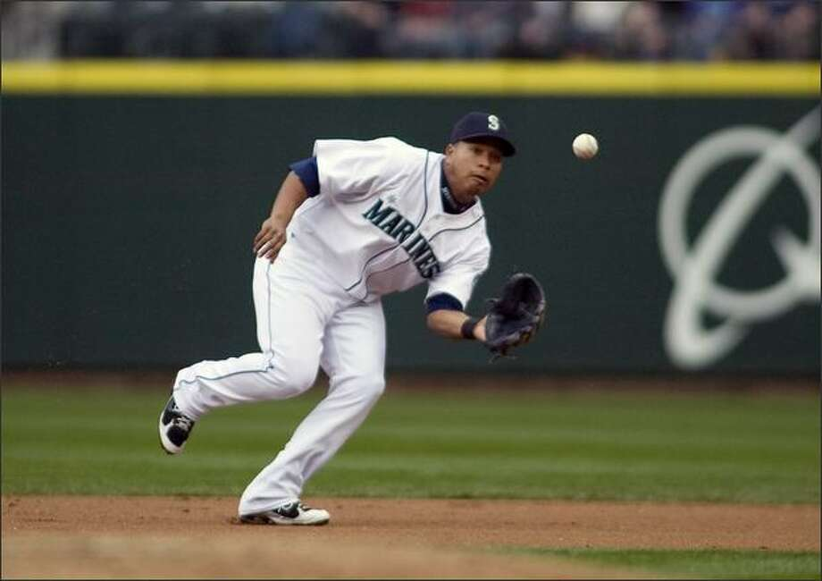 Seattle Mariners second baseman Jose Lopez fields a ground ball hit by Oakland Athletics' Emil Brown in the second inning of their baseball game in Seattle on Saturday, April 26, 2008. (AP Photo/Jim Bryant) Photo: Associated Press / Associated Press