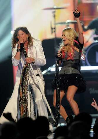 LAS VEGAS, NV - APRIL 03:  Singers Steven Tyler (L) and Carrie Underwood perform onstage at the 46th Annual Academy Of Country Music Awards held at the MGM Grand Garden Arena on April 3, 2011 in Las Vegas, Nevada.  (Photo by Ethan Miller/Getty Images) *** Local Caption *** Steven Tyler;Carrie Underwood Photo: Ethan Miller, Getty Images / 2011 Getty Images