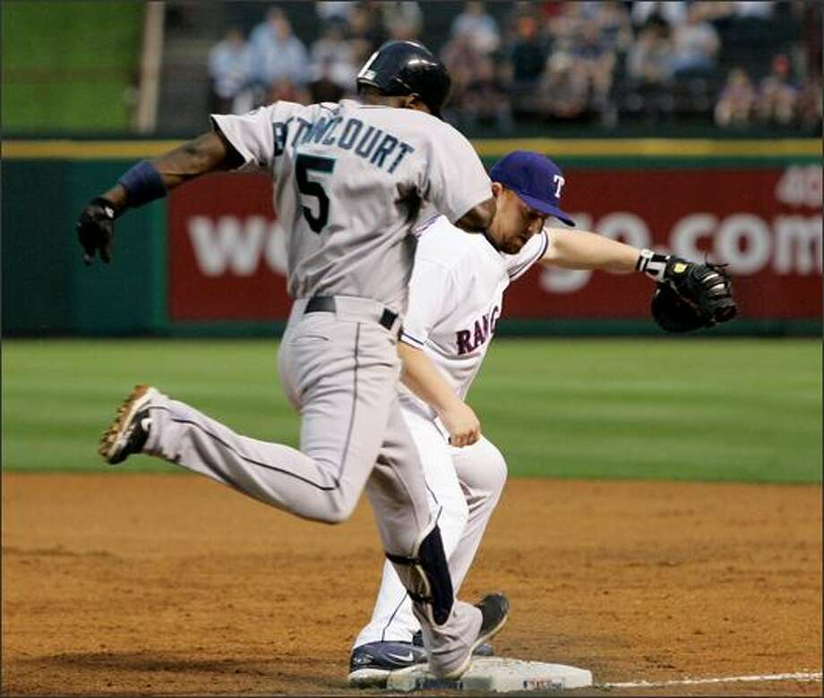 Rangers first baseman Chris Shelton, right, steps on the bag to get the out against Yuniesky Betancourt in the third inning. Photo: Associated Press / Associated Press