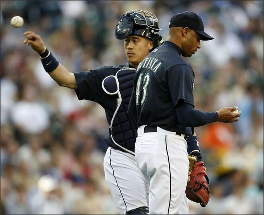 Mariners catcher Kenji Johjima visits the mound in the third inning to calm down pitcher Miguel Batista. The right-hander gave up six earned runs in 5 1/3 innings. Photo: Mike Urban, Seattle Post-Intelligencer / Seattle Post-Intelligencer