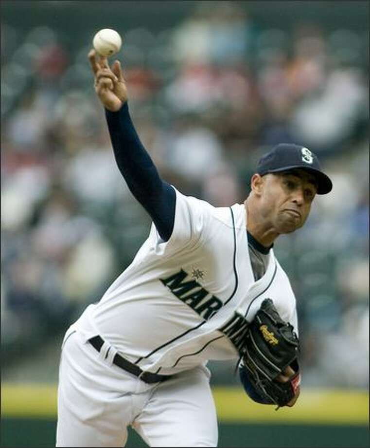 Seattle Mariners starter Miguel Batista pitches against the Detroit Tigers in the first inning. Photo: Jim Bryant, Associated Press / Associated Press