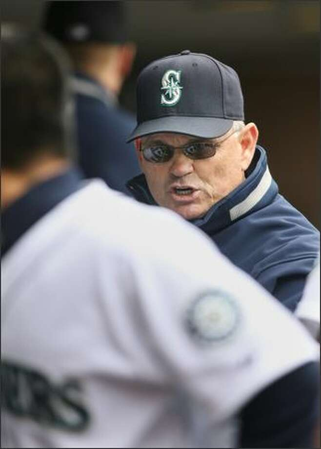 Seattle Mariners manager John McLaren appeared to have some stern words for catcher Kenji Johjima (foreground) in the dugout after starting pitcher Carlos Silva gave up three runs to the Los Angeles Angels in the first inning at Safeco Field. The Angels won 5-4, sweeping the M's in the three game series. Photo: Dan DeLong, Seattle Post-Intelligencer / Seattle Post-Intelligencer