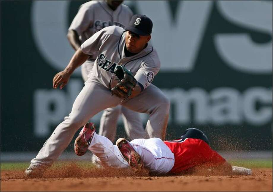 Jose Lopez, top, can't make the tag on Boston's Coco Crisp as he steals second base during the third inning. Photo: Associated Press / Associated Press