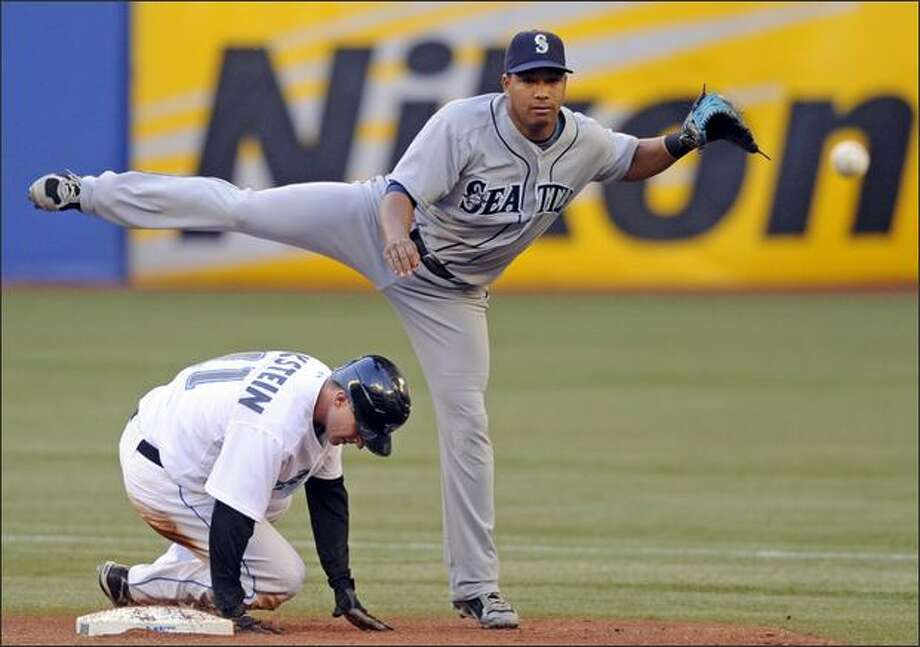 Mariners second baseman Jose Lopez, top, throws to first as Toronto's David Eckstein slides unsuccessfully into second base in the third inning. Photo: Associated Press / Associated Press