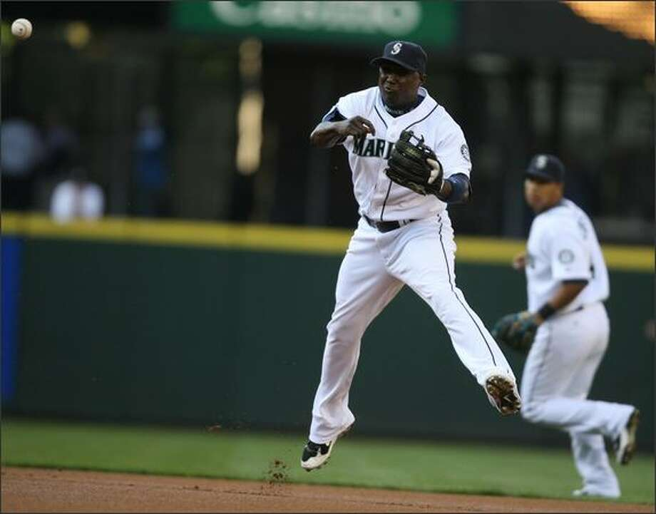 Yuniesky Betancourt goes deep into the hole behind second base on the first play of the game to scoop and throw out Hanley Ramirez in the first inning as the Seattle Mariners play the Florida Marlins at Safeco Field. Photo: Scott Eklund, Seattle Post-Intelligencer / Seattle Post-Intelligencer