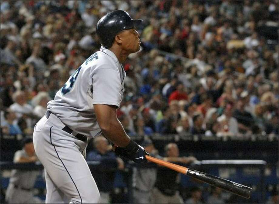 Adrian Beltre watches his RBI double against the Braves during the sixth inning. Photo: Associated Press / Associated Press