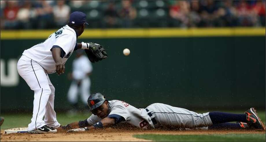 Yuniesky Betancourt, left, waits for the throw as Detroit's Curtis Granderson makes it to second for a double in the fifth inning. Photo: Associated Press / Associated Press