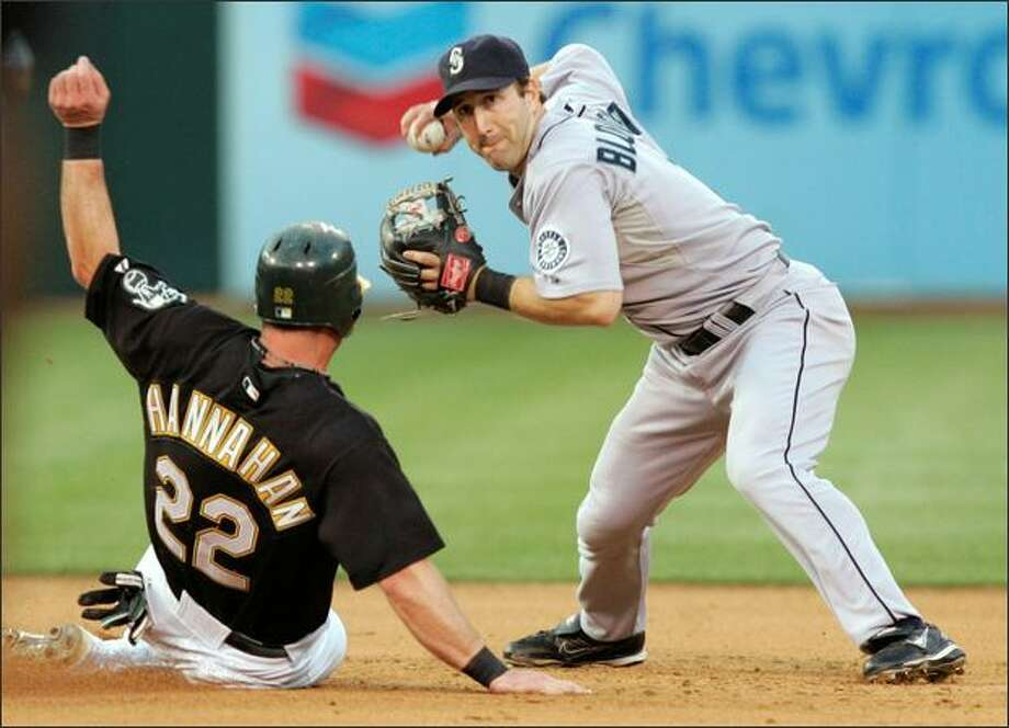 Mariners shortstop Willie Bloomquist, right, forces out Oakland's Jack Hannahan (22) at second base after a ground ball by Ryan Sweeney in the fifth inning. Sweeney was safe at first. Photo: Associated Press / Associated Press