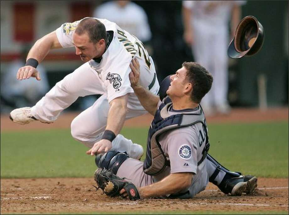 Jack Hannahan collides with Jeff Clement at home plate. Photo: Associated Press / Associated Press