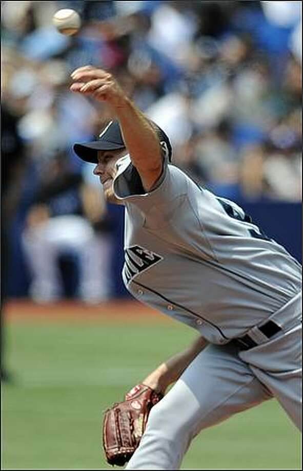 Seattle Mariners Jarrod Washburn delivers a pitch against the Toronto Blue Jays during the first inning in Toronto on Sunday. The subject of trade rumors, Washburn shook off the speculation to win for the first time in four starts. He gave up one run and four hits, walked two and struck out two in Seattle's 5-1 win. Photo: Aaron Harris, AP Photo/The Canadian Press / AP Photo/The Canadian Press