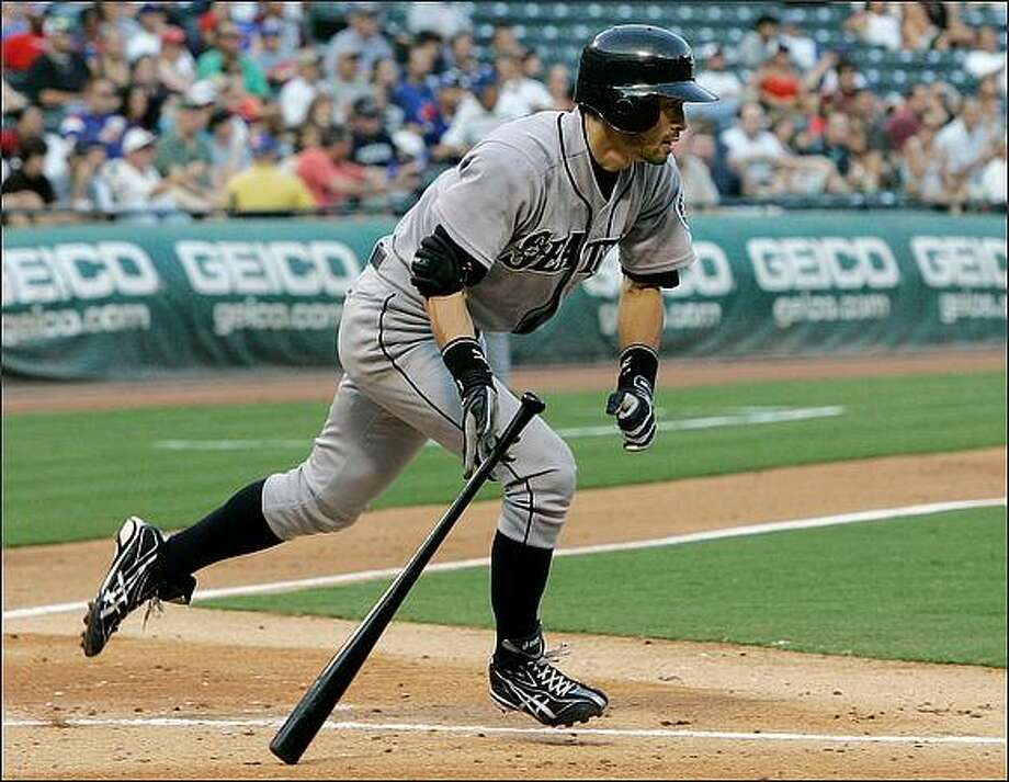 Seattle Mariners' Ichiro Suzuki looks to at his deep double to right in the second inning against the Texas Rangers in Thursday's game, an 8-5 win by Seattle.