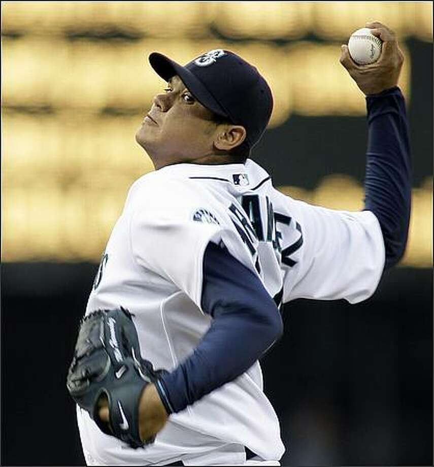 Seattle Mariners starting pitcher Felix Hernandez throws against the Tampa Bay Rays in the fourth inning. (AP Photo/Ted S. Warren)