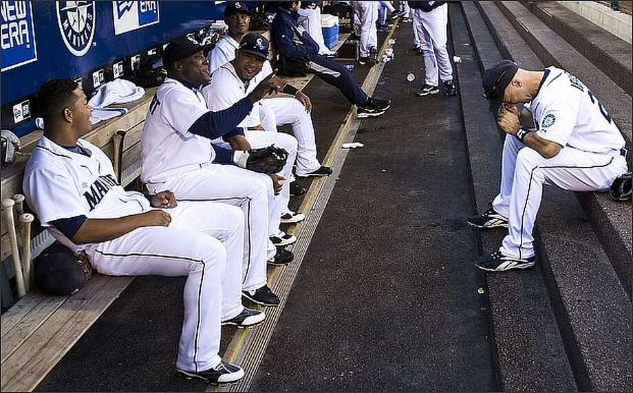 Mariners players, including Raul Ibanez, right, and Yuniesky Betancourt joke around before taking the field for Sunday's game versus the Oakland Athletics at Safeco Field. Photo: Brad Vest, Seattle Post-Intelligencer / Seattle Post-Intelligencer