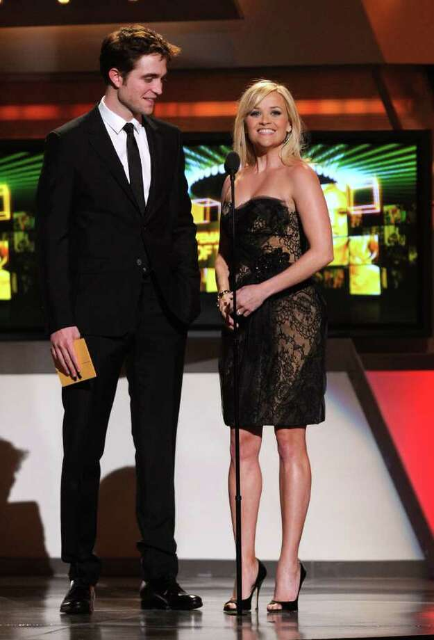 LAS VEGAS, NV - APRIL 03:  Actors Robert Pattinson and Reese Witherspoon speak onstage at the 46th Annual Academy Of Country Music Awards held at the MGM Grand Garden Arena on April 3, 2011 in Las Vegas, Nevada.  (Photo by Ethan Miller/Getty Images) *** Local Caption *** Robert Pattinson;Reese Witherspoon Photo: Ethan Miller, Getty Images / 2011 Getty Images