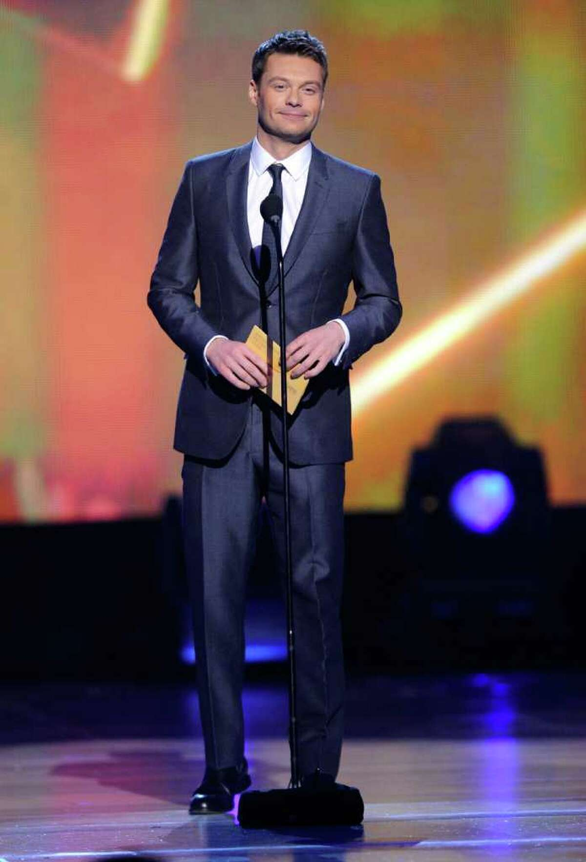 LAS VEGAS, NV - APRIL 03: Ryan Seacrest speaks onstage at the 46th Annual Academy Of Country Music Awards held at the MGM Grand Garden Arena on April 3, 2011 in Las Vegas, Nevada. (Photo by Ethan Miller/Getty Images) *** Local Caption *** Ryan Seacrest