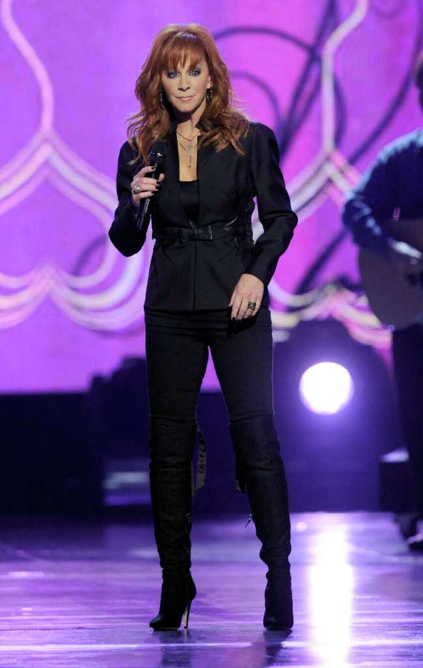 LAS VEGAS, NV - APRIL 03: Host Reba McEntire performs onstage at the 46th Annual Academy Of Country Music Awards held at the MGM Grand Garden Arena on April 3, 2011 in Las Vegas, Nevada. (Photo by Ethan Miller/Getty Images) *** Local Caption *** Reba McEntire