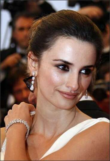 Penelope Cruz poses as she arrives at the premiere for the film