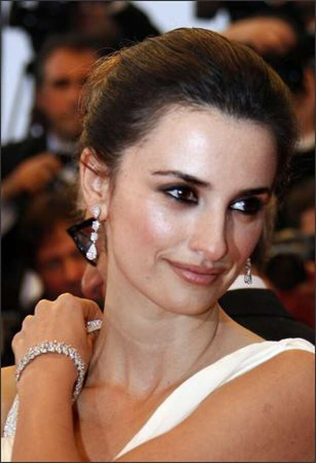 """Penelope Cruz poses as she arrives at the premiere for the film """"Vicky Cristina Barcelona."""" Photo: Getty Images / Getty Images"""