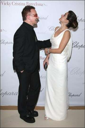 Musician Bono and actress Penelope Cruz attend the Chopard Party.