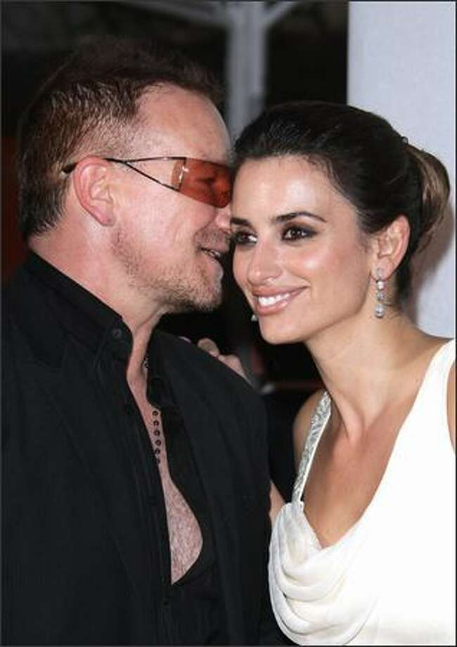 Musician Bono and actress Penelope Cruz attend the Chopard Party. Photo: Getty Images / Getty Images